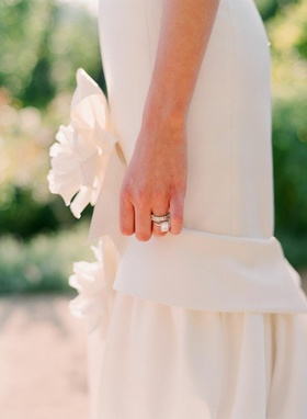 Bride wearing ring and eternity band