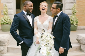 bride in hayley paige laughes with two bridesmen in navy tuxedos