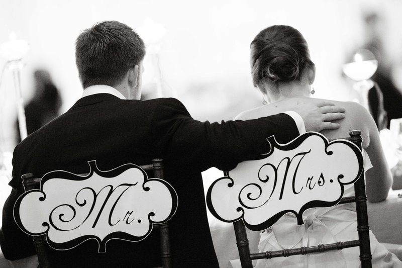 Black and white photo of sweetheart chair signs