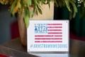American flag-themed sign displaying wedding hashtag