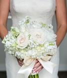 light hued bridal bouquet jewel accents rose bow classic wedding florals