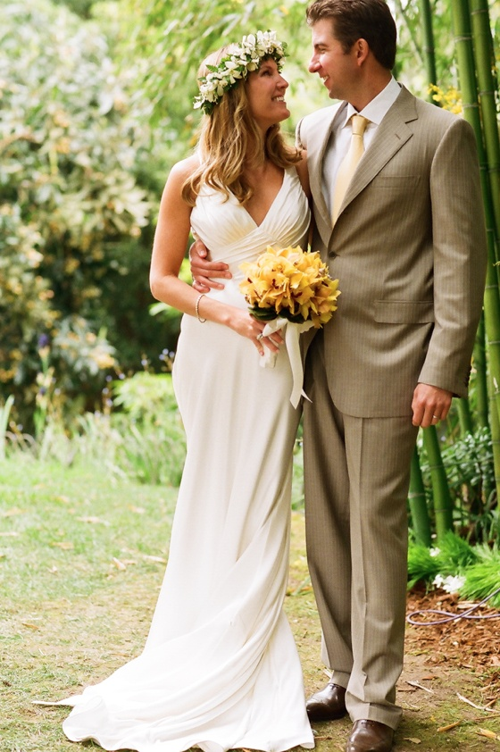 Bride in white dress and groom in tan suit