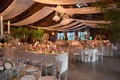 rustic venue with wooden ceilings, drapery and twinkle lights