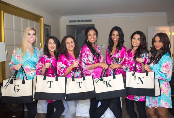 bridesmaids in silk floral robes hold monogrammed tote bags, bridesmaids gift