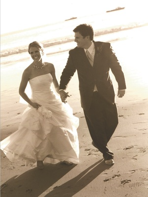 Sepia toned photo of couple on beach
