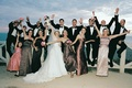 Silly couple with bridesmaids, groomsmen, flower girl, and ring bearer