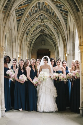 Bride and blue bridesmaids at Duke Chapel