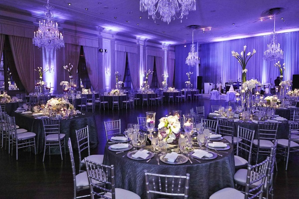 Ballroom wedding with purple lighting and silver details