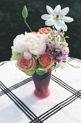 Pink vase with pink rose, light pink peony, and purple flower