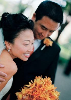 Bride wearing diamond drop earrings