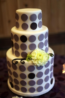 Three layer wedding cake with purple circle decorations