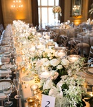 long king's table with chameleon chairs, small centerpieces and candles form