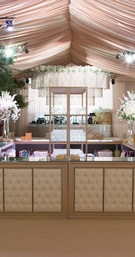 Four sided wedding bar with tufted panels