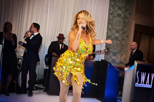 Jenilca Giusti sings at friends wedding in gold sequin dress