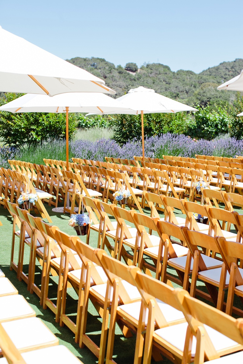 Alfresco wedding chair rows and umbrellas