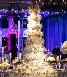 11-foot tall wedding cake with aspen bark for tiers and fresh flowers in between