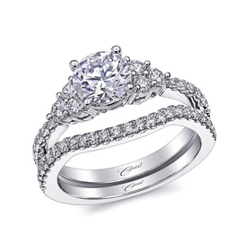 Three-stone ring with diamond shank and matching band
