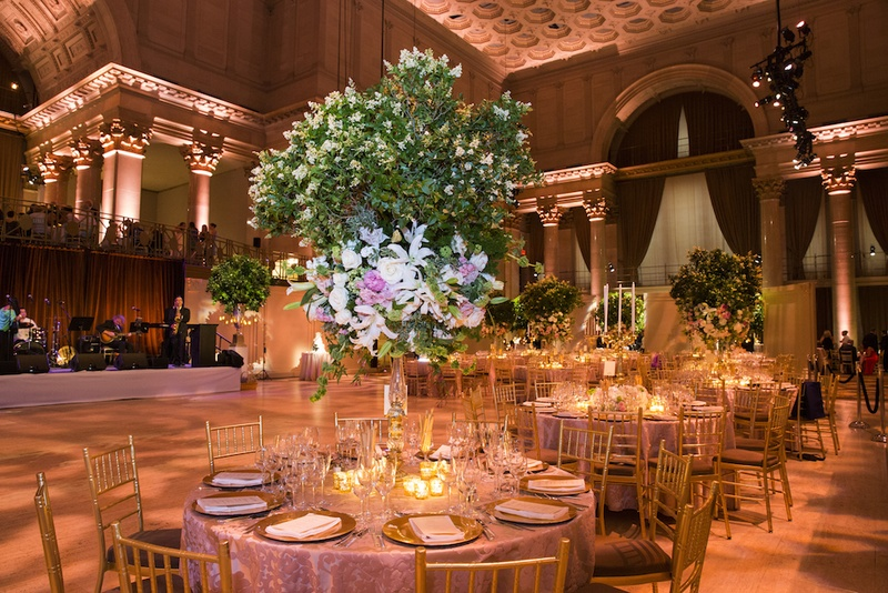 Romantic garden inspired summer wedding in new york city inside ballroom wedding with green tree centerpiece and gold decorations junglespirit