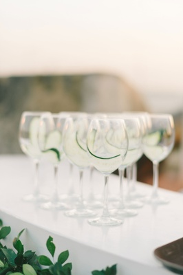 wedding ceremony drink glasses with cucumber slices prepared
