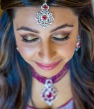 Indian bride wearing sparkling headpiece and bold eyeshadow