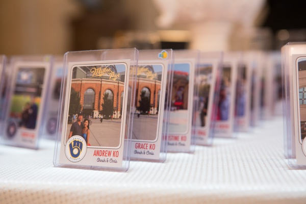 Wedding reception with personalized place cards in the form of baseball cards with photos of couple