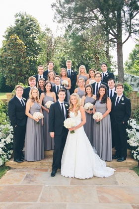 Young couple with bridesmaids and groomsmen