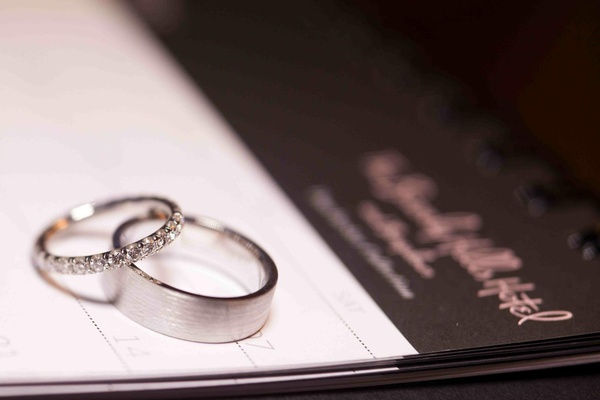 Wedding rings on top of Beverly Hills Hotel stationery