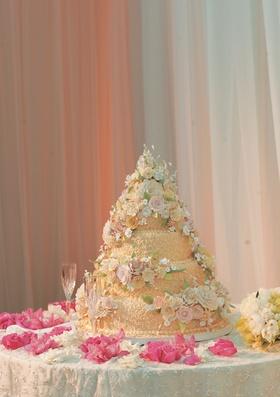 Orange-yellow cake in cone shape with flower design