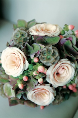 Bouquet with peach rose and green hydrangea flowers and scabiosa pods