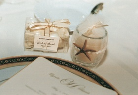 Votive candle and chocolates wrapped for guests