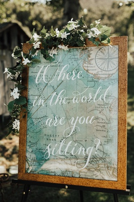 "framed map with ivy reading ""where in the world are you sitting?"""