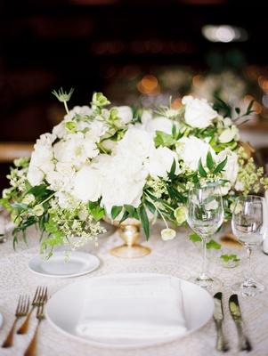wedding reception short flower centerpiece white blooms greenery gold vessel footed