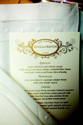 Wedding reception menu with gold design and type