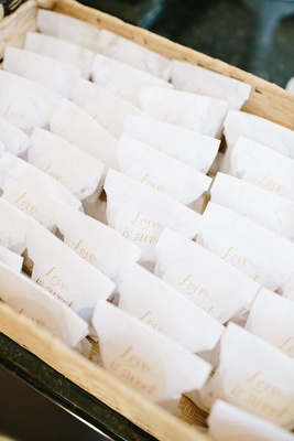 wedding favors in basket white bags with love is sweet in gold calligraphy baklava favors