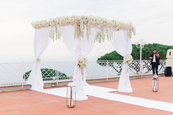 destination wedding in capri, italy, white chuppah with dendrobium orchids and white chiffon