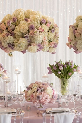 Tall flower arrangement with white hydrangea rose purple pink flowers low centerpiece purple tulips