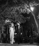 black and white photo couple holding hands outside park wedding dress tuxedo chicago happy