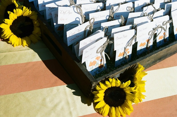 Tables assignments in wood crate with sunflowers