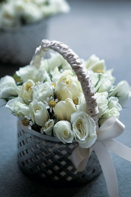 Taupe-purple basket filled with cream flowers
