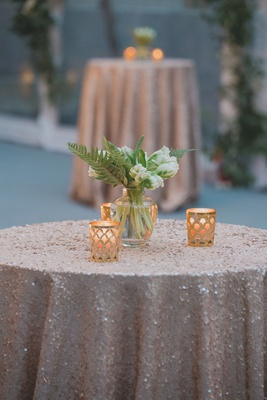wedding reception cocktail hour small tables with sequin linens gold candle votives bud vases white