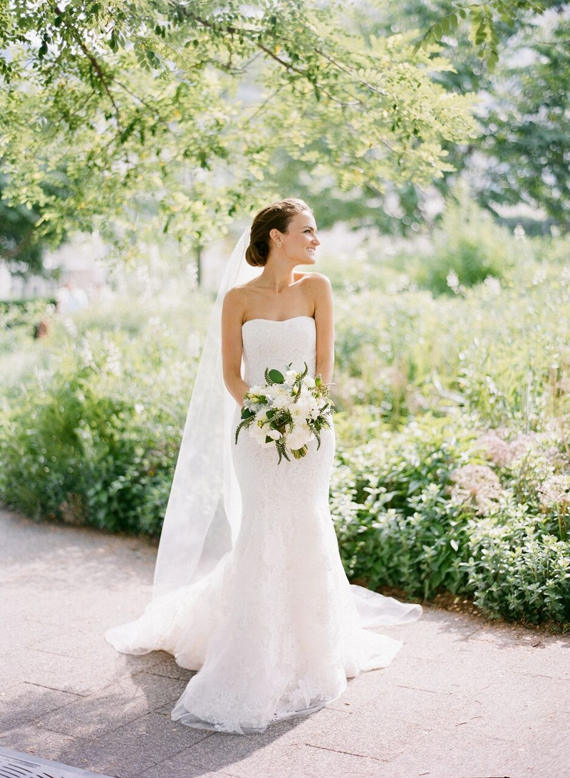 bride in vera wang lace gown in garden setting in Chicago