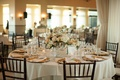 centerpieces with blush roses, dusty miller, and eucalyptus, gold plates chiavari chairs