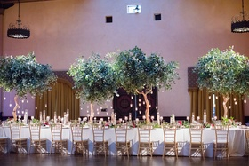 wedding reception, trees with hanging candles as centerpieces