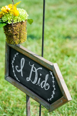 """I Did"" wedding sign on chalkboard with moss arrangement"
