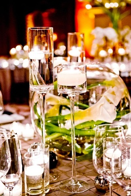 Large crystal candlesticks filled with water