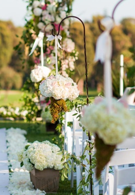 Outdoor ceremony floral arrangements