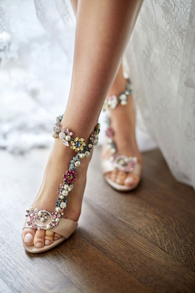 bride with pedicure and wedding shoes pretty jimmy choo pink sandals with blue yellow pink white