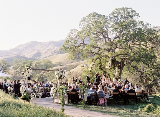 Ranch wedding in Bakersfield California greenery arch white flowers Mindy Weiss