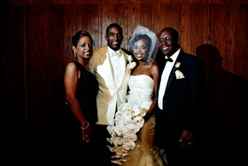 Jarett Dillard with bride and parents at wedding