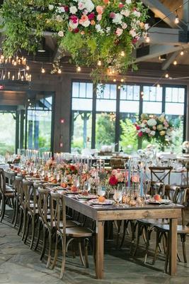 wedding reception old edwards inn wood tables pink orange flower centerpiece bistro lights